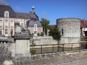 Étoges castle - Facade of the castle with its tower and its moats