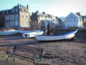 Étretat - Bench, pebbles, boats and houses of the city (seaside resort)