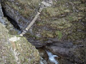 Étroits gorge - Gorges: bridge of the via ferrata spanning the river and rock faces; in Dévoluy
