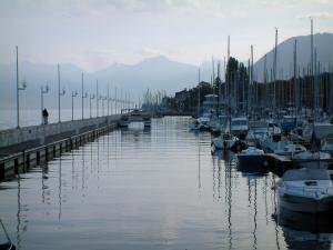 Évian-les-Bains - Port with boats and sailboats, line of lampposts, Lake Geneva and mountains