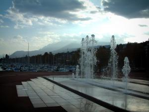 Évian-les-Bains - Fountains, boats in the port, mountains and cloudy sky