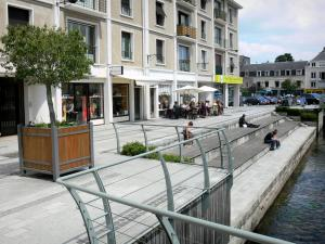 Évreux - Walk along River Iton, potted tree, café terrace and buildings of the town