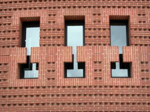 Évry - Detail of the St. Corbinian Cathedral of the Resurrection: brick facade pierced by windows