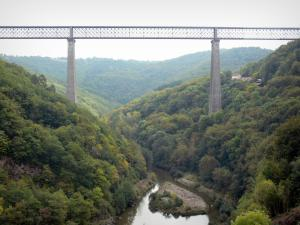 Fades Viaduct - Railway bridge (one of the highest in Europe) overhanging the river Sioule and hills covered with forests; in the town of Sauret-Besserve