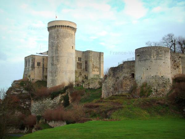 Falaise - William the Conqueror castle (Talbot tower, big keep, and small keep) on a rocky mountain spur, tower of the castral surrounding wall, and clouds in the sky