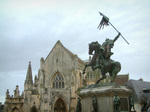 Falaise - Guillaume-le-Conquérant's statue, the Trinity church, and cloudy sky