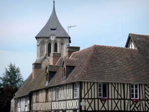 La Ferrière-sur-Risle - Facades of half-timbered houses and bell tower of the Saint-Georges church