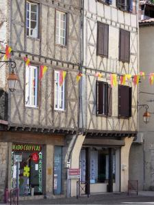 Foix - Facades of timber-framed houses, shops and pennants in the old town