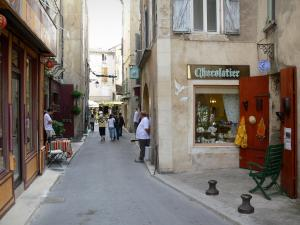 Forcalquier - Street in the old town lined with houses and shops