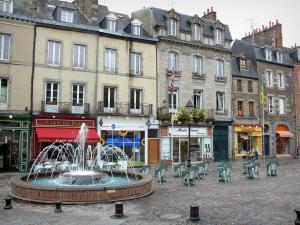Fougères - Aristide-Briand square: fountain, shops and houses
