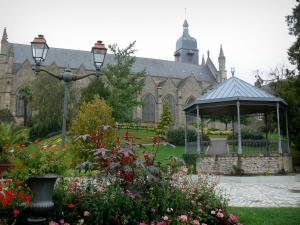 Fougères - Saint Léonard church and public garden with its bandstand, its lamppost, its trees, its lawns and its flowers