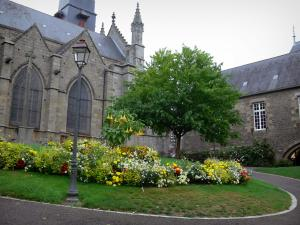 Fougères - Saint Léonard church, town hall and public garden with tree, lamppost, lawn and flowers