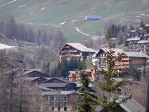 La Foux d'Allos - Chalets of the ski resort of Val d'Allos 1800, trees, ski lift and meadows
