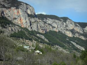 Freissinières valley - Rock faces, houses and trees; in the Écrins National Nature Park