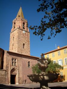 Fréjus - Fountain of the Formigé square and branches of a tree in foreground, cathedral (Episcopal set) and town hall