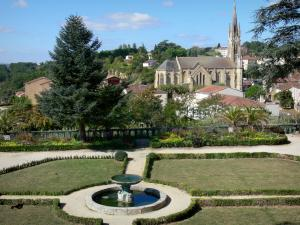 Fumel - French-style formal garden of the château overlooking the Saint-Antoine church and the houses of the town