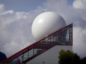 Futuroscope theme park - White sphere and glass prism of the Futuroscope pavilion (building with a futuristic architecture)
