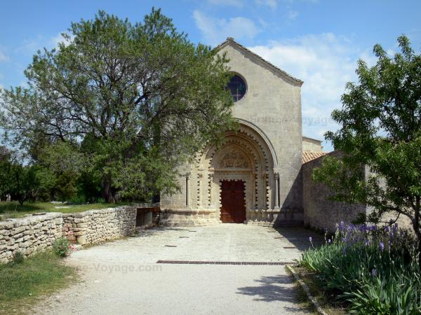 Ganagobie monastery - Romanesque church of the Benedictine convent and path lined with trees and iris (flowers)