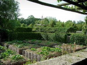 Gardens of the Notre-Dame d'Orsan priory - Vegetable garden of medieval style and trees