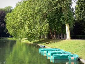 Gardens of the Palace of Fontainebleau - Carp pond, trees and boats moored at the waterfront