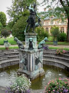 Gardens of the Palace of Fontainebleau - Diane fountain and its dogs made of bronze, flowers and trees of the Diane garden