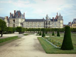 Gardens of the Palace of Fontainebleau - Large flowerbed (French-style formal garden), alleys of linden trees and facades of the Palace of Fontainebleau