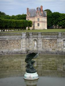 Gardens of the Palace of Fontainebleau - Pond of the waterfalls and bronze eagle statue, Sully pavilion and trees of the park in the background