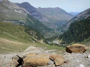 Gavarnie cirque - Rocks in foreground with a view of the cirque's hotel down below, the village of Gavarnie and the mountains bordering the Gavarnie valley; in the Pyrenees National Park
