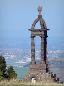 Gergovie plateau - Commemorative monument topped with a winged helmet dedicated to Vercingetorix, view of the city of Clermont-Ferrand; in La Roche-Blanche