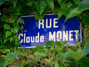 Giverny - Sign of the Rue Claude Monet street surrounded by ivy