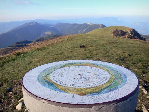Grand Colombier - Viewpoint indicator at the summit of Grand Colombier (Jura mountain range, in Bugey) with a view of the surrounding unspoiled landscape