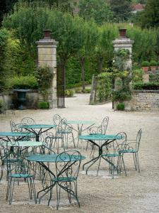 Grand Jardin castle - Tables and wrought iron chairs, garden of the castle; in the town of Joinville