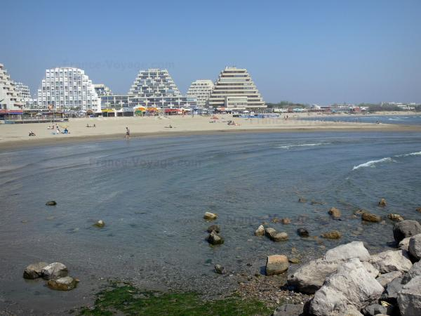 La Grande-Motte - Pyramid-shaped buildings, sandy beach of the seaside resort, Mediterranean Sea and cliffs
