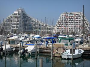 La Grande-Motte - Seaside resort: pyramid-shaped buildings, boats and sailboats of the sailing port