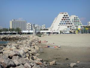 La Grande-Motte - Sandy beach, breakwaters and buildings of the seaside resort