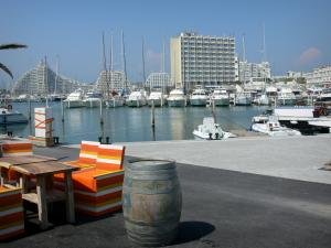 La Grande-Motte - Café terrace, sailing port with its boats and its sailboats, and buildings of the seaside resort