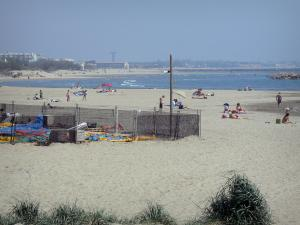 La Grande-Motte - Sandy beach of the seaside resort with holidaymakers, Mediterranean Sea