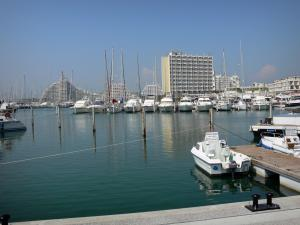 La Grande-Motte - Sailing port with its boats and its sailboats, and buildings of the seaside resort