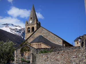 La Grave - Bell tower of the Notre-Dame-de-l'Assomption church, stone enclosing wall of the cemetery and mountain