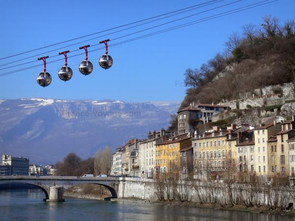 Grenoble - Bulles of the cable car of Grenoble Bastille, house facades, bridge spanning River Isère, trees and mountains