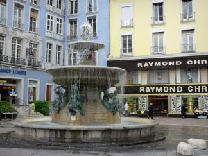 Grenoble - Place Grenette square: fountain, shops and facades of houses