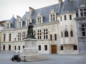 Grenoble - Facade of the former Palace of the Dauphiné Parliament (former courthouse) of Flamboyant Gothic style, and statue of Knight Bayard on the Place Saint-André square