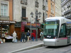 Grenoble - Tram, shops, lamppost and walls of the old town