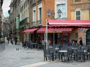 Grenoble - Café terrace of the Place Sainte-Claire square and facade of houses in the old town