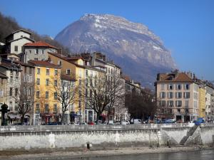 Grenoble - Facades of houses in the town, River Isère, trees and Mount Saint-Eynard (Chartreuse mountains)