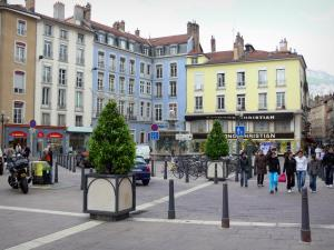 Grenoble - Facades and shops of the Place Grenette square