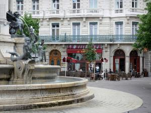 Grenoble - Place Notre-Dame square: Trois Ordres fountain, café terrace and facade of a building