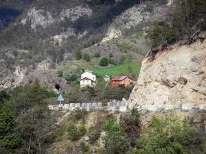 Guil gorges - Gorges road, houses, trees and mountain; in the Queyras Regional Nature Park