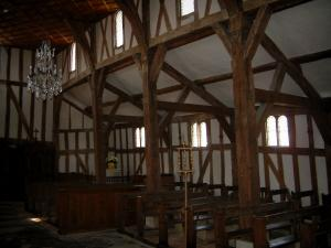 Half-timbered church - Wooden inside (visible beams) of the Saint-Jacques et Saint-Philippe church in the village of Lentilles