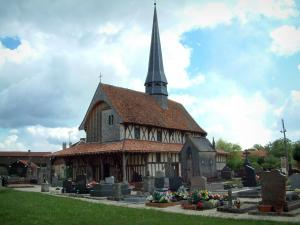 Half-timbered church - Cemetery and half-timbered church in Bailly-le-Franc, clouds in the sky